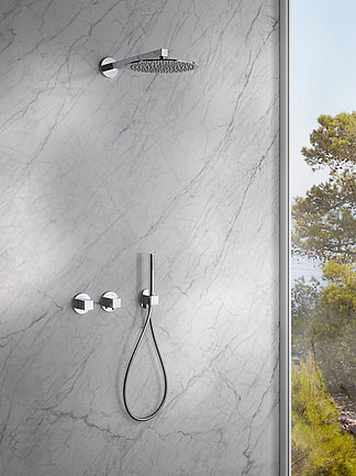 Shower tap on gray wall