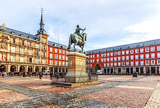 Plaza Mayor with equestrian statue and people walking on the square