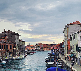 Canal in Murano with colorful facades and boats