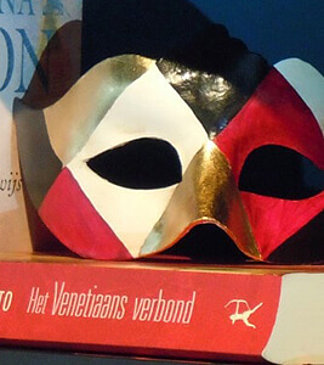 typical mask from venice with red gold and black pattern