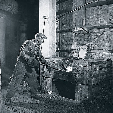 Worker standing by the blast furnace