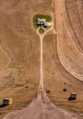 Photography of a farm with bales in an unusual perspective